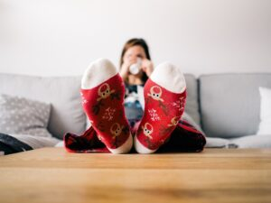 woman feet up holiday socks couch coffee, calgary, yyc, winter, christmas cleaning, decluttering, clutter-free, seasonal, storage, storage company