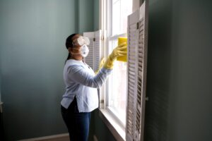 woman wiping down window for cleaning new year resolutions,calgary yyc, crate it storage